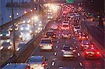 Traffic on busy highway at twilight Stock Photo - Premium Royalty-Free, Artist: Allan Baxter, Code: 614-06718432