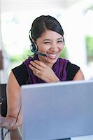 switchboard operator - Businesswoman wearing headset at desk Stock Photo - Premium Royalty-Freenull, Code: 614-06718463