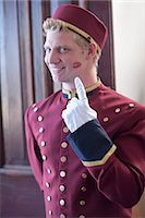 funny pose - Bellhop smiling with kiss print on cheek Stock Photo - Premium Royalty-Freenull, Code: 614-06718562