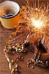 Sparkler, doughnut and cup of coffee Stock Photo - Premium Royalty-Free, Artist: Westend61, Code: 614-06718729