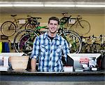 Cashier working in bicycle shop Stock Photo - Premium Royalty-Free, Artist: Blend Images, Code: 614-06718756