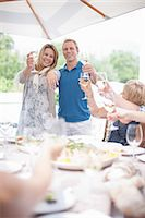 Couple making toast at table Stock Photo - Premium Royalty-Freenull, Code: 614-06718825