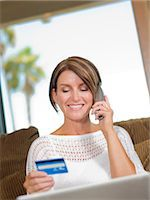 person on phone with credit card - Woman shopping on telephone Stock Photo - Premium Royalty-Freenull, Code: 614-06718885