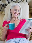 Older woman reading newspaper on bed Stock Photo - Premium Royalty-Free, Artist: CulturaRM, Code: 614-06718897