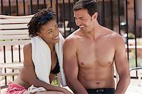 shirtless men - Couple relaxing by swimming pool Stock Photo - Premium Royalty-Freenull, Code: 614-06719017