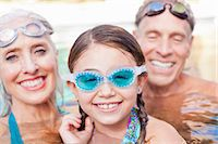 Girl and grandparents swimming in pool Stock Photo - Premium Royalty-Freenull, Code: 614-06719042