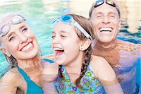 Girl and grandparents swimming in pool Stock Photo - Premium Royalty-Freenull, Code: 614-06719043