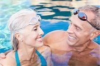 Older couple swimming in pool Stock Photo - Premium Royalty-Freenull, Code: 614-06719044