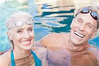 Older couple swimming in pool Stock Photo - Premium Royalty-Freenull, Code: 614-06719048