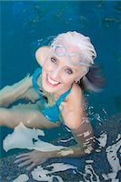 Older woman swimming in pool Stock Photo - Premium Royalty-Freenull, Code: 614-06719049