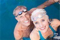 Older couple swimming in pool Stock Photo - Premium Royalty-Freenull, Code: 614-06719050