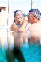 Couple swimming together in pool Stock Photo - Premium Royalty-Freenull, Code: 614-06719052