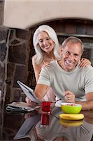 Older couple smiling at breakfast Stock Photo - Premium Royalty-Freenull, Code: 614-06719056