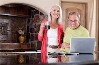 Older couple using laptop at breakfast Stock Photo - Premium Royalty-Freenull, Code: 614-06719059