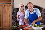 Older couple cooking in kitchen Stock Photo - Premium Royalty-Free, Artist: Kablonk! RM, Code: 614-06719075