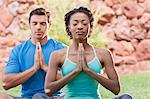 Couple meditating together outdoors Stock Photo - Premium Royalty-Free, Artist: Cultura RM, Code: 614-06719137