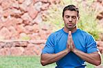Man meditating outdoors Stock Photo - Premium Royalty-Free, Artist: urbanlip.com, Code: 614-06719140