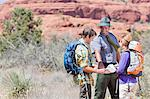 Hikers talking to park ranger Stock Photo - Premium Royalty-Free, Artist: Cultura RM, Code: 614-06719147