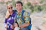 Hikers smiling in rural landscape Stock Photo - Premium Royalty-Free, Artist: Daisy Gilardini, Code: 614-06719149