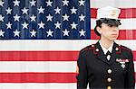 Servicewoman in dress blues by US flag Stock Photo - Premium Royalty-Free, Artist: Matt Brasier, Code: 614-06719170