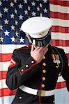 Serviceman in dress blues by US flag Stock Photo - Premium Royalty-Free, Artist: CulturaRM, Code: 614-06719183