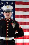 Serviceman in dress blues by US flag Stock Photo - Premium Royalty-Free, Artist: CulturaRM, Code: 614-06719185