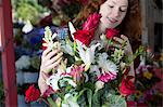 Florist arranging bouquet in shop Stock Photo - Premium Royalty-Free, Artist: Blend Images, Code: 614-06719188