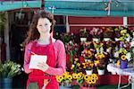 Florist making notes in shop Stock Photo - Premium Royalty-Free, Artist: Blend Images, Code: 614-06719200