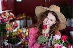 Florist smelling flowers in shop Stock Photo - Premium Royalty-Free, Artist: Ikonica, Code: 614-06719209