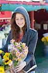 Woman buying flowers at florist Stock Photo - Premium Royalty-Free, Artist: Blend Images, Code: 614-06719216