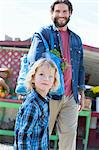 Father and son at farmer's market Stock Photo - Premium Royalty-Free, Artist: AWL Images, Code: 614-06719230
