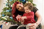 Mother and daughter with Christmas gift Stock Photo - Premium Royalty-Free, Artist: Blend Images, Code: 614-06719296