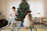 Children playing around Christmas tree Stock Photo - Premium Royalty-Free, Artist: Cultura RM, Code: 614-06719323