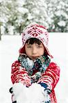 Boy holding snowball outdoors Stock Photo - Premium Royalty-Free, Artist: Blend Images, Code: 614-06719336