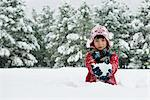 Boy holding snowball outdoors Stock Photo - Premium Royalty-Free, Artist: CulturaRM, Code: 614-06719338
