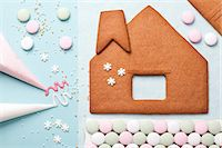 snowflakes  holiday - Gingerbread house components on table Stock Photo - Premium Royalty-Freenull, Code: 614-06719347