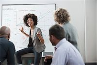 Businesswoman talking in meeting Stock Photo - Premium Royalty-Freenull, Code: 614-06719438