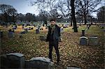 Man visiting graveyard Stock Photo - Premium Royalty-Free, Artist: Blend Images, Code: 614-06719567