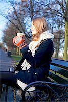 Woman having coffee on park bench Stock Photo - Premium Royalty-Freenull, Code: 614-06719605