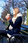 Woman having coffee on park bench Stock Photo - Premium Royalty-Free, Artist: Photocuisine, Code: 614-06719605
