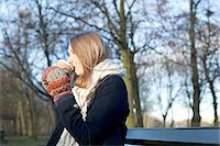 Woman having coffee on park bench Stock Photo - Premium Royalty-Freenull, Code: 614-06719606