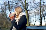 Woman having coffee on park bench Stock Photo - Premium Royalty-Free, Artist: photo division, Code: 614-06719606