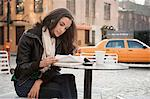 Woman reading at sidewalk cafe Stock Photo - Premium Royalty-Free, Artist: Blend Images, Code: 614-06719698