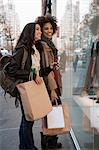 Women window shopping on city street Stock Photo - Premium Royalty-Free, Artist: Blend Images, Code: 614-06719710