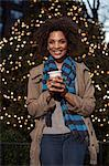 Woman having coffee on city street Stock Photo - Premium Royalty-Free, Artist: Blend Images, Code: 614-06719716