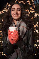 Woman having coffee on city street Stock Photo - Premium Royalty-Freenull, Code: 614-06719717