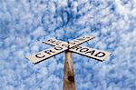 'Railroad crossing' sign under blue sky Stock Photo - Premium Royalty-Free, Artist: Universal Images Group, Code: 614-06719744