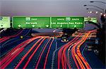 Blurred view of traffic on highway Stock Photo - Premium Royalty-Free, Artist: Ikon Images, Code: 614-06719764
