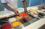 Cashier organizing toppings in store Stock Photo - Premium Royalty-Free, Artist: Cultura RM, Code: 614-06719812