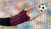 Soccer player catching ball in air Stock Photo - Premium Royalty-Freenull, Code: 614-06719868